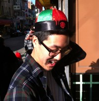 Stereotypical hats in Chinatown (even though Chris is Korean)